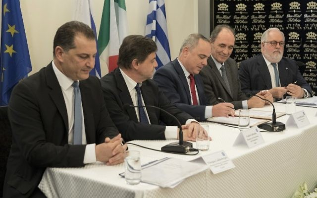 Energy Minister Yuval Steinitz (2nd R), Cypriot Minister of Energy, Commerce, Industry and Tourism, Yiorgos Lakkotrypis (L) and Greek Economy minister Giorgos Stathakis after signing a pledge to build the world's longest undersea gas pipeline, April 3, 2017. (AFP Photo/Jack Guez)Italy, Israel, Greece and Cyprus pledged to move ahead on the world's longest undersea gas pipeline to take it from the eastern Mediterranean to southern Europe, with support from the European Union. / AFP PHOTO / JACK GUEZ
