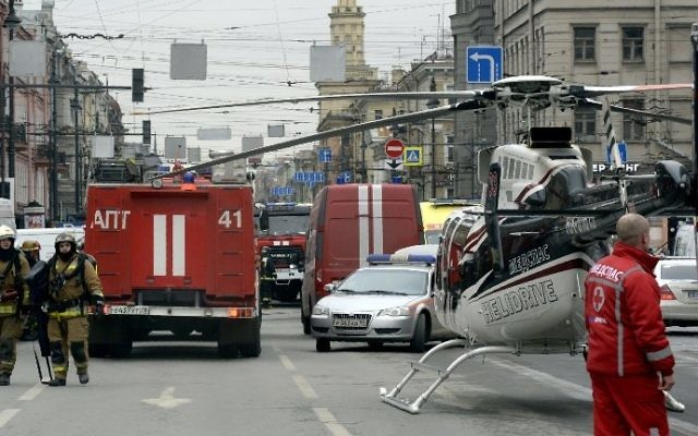 Emergency services personnel and vehicles are seen at the entrance to the Technological Institute metro station in Saint Petersburg on April 3, 2017. (AFP Photo/Olga Maltseva)