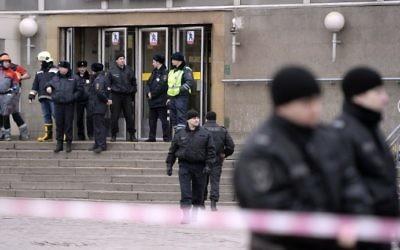 Illustrative: Police officers guard the entrance to Sennaya Square metro station in St. Petersburg, on April 3, 2017. (AFP Photo/Olga Maltseva)