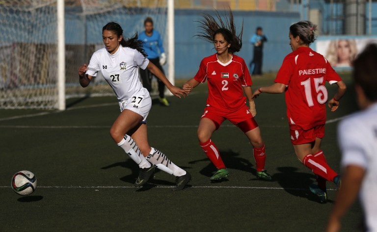 890ade34a Palestinian female football players (in red) are seen during a qualifying  match against Thailand