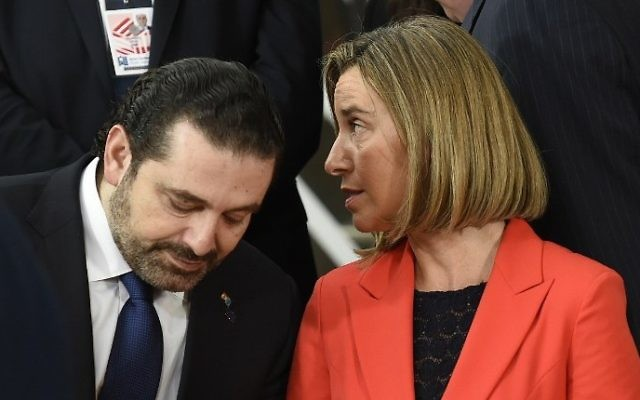 Lebanese Prime minister Saad Al Hariri , left, listens to EU High Representative of the Union for Foreign Affairs and Security Policy Federica Mogherini ahead of a conference on Syria and the region, in Brussels, April 5, 2017. (AFP/JOHN THYS)