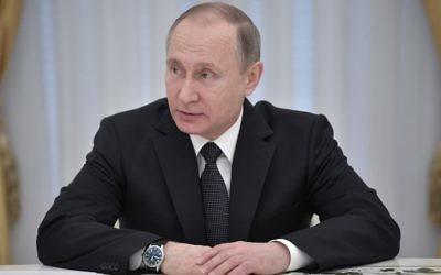 Russian President Vladimir Putin chairs a meeting at the Kremlin in Moscow on April 5, 2017. (AFP Photo/Sputnik/Aleksey Nikolskyi)