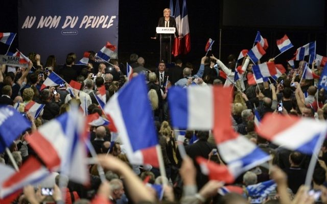 French presidential election candidate for the far-right Front National (FN) party Marine Le Pen gestures as she speaks during a rally in Monswiller, north-eastern France, on April 5, 2017. (AFP PHOTO / Sebastien Bozon)
