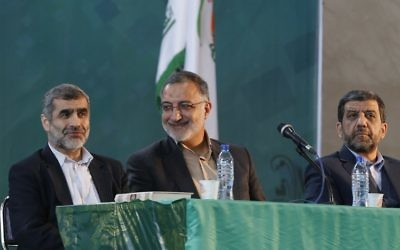 Iranian presidential candidates Ezzatollah Zarghami (R), Alireza Zakani (C) and Ali Nikzad (L) attend the general assembly of conservatives, in Tehran, on April 6, 2017 to decide on a shortlist of five candidates for the presidential election. (AFP/STR)