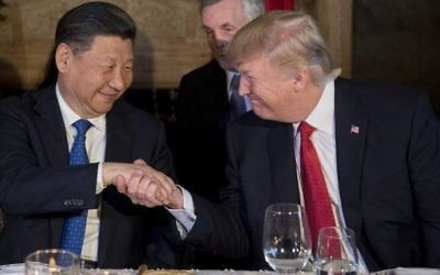 US President Donald Trump (R) and Chinese President Xi Jinping (L) shake hands during dinner at the Mar-a-Lago estate in West Palm Beach, Florida, on April 6, 2017. (AFP Photo/Jim Watson)
