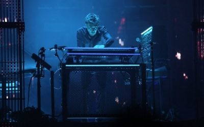 Electronic music pioneer Jean-Michel Jarre performs during concert to publicize the plight of the shrinking Dead Sea, the lowest place on earth, at the foot of the ancient clifftop fortress of Masada in Israel on April 6, 2017. (AFP/Menahem Kahana)