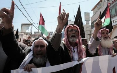 Palestinian supporters of the Islamic Jihad terror group take part in a protest in the southern Gaza Strip town of Khan Yunis on April 7, 2017. (AFP Photo/Said Khatib)