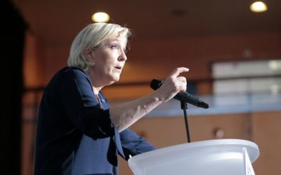 French presidential election candidate for the far-right Front National party Marine Le Pen delivers a speech during a campaign meeting at the Palais des Congres in Ajaccio on the French Mediterranean island of Corsica, on April 8, 2017. (AFP Photo/Pascal Pochard-Casabianca)