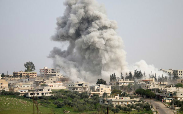 Smoke billows following a reported air strike on a rebel-held area in the southern Syrian city of Daraa, on April 8, 2017. (Mohamad Abazeed/AFP)