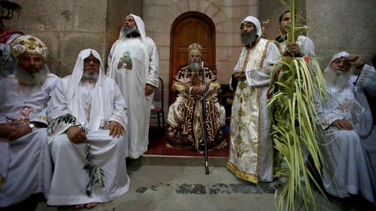 The 22nd Coptic Metropolitan of Jerusalem and the Near East Metropolitan Anba Antonious (C) leads the Palm Sunday Easter procession at the Church of the Holy Sepulchre in Jerusalem's Old City on April 9, 2017. (AFP Photo/Gali Tibbon)