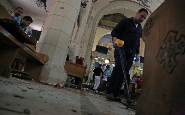 A general view shows forensics collecting evidence at the site of a bomb blast which struck worshippers gathering to celebrate Palm Sunday at the Mar Girgis Coptic Church in the Nile Delta City of Tanta on April 9, 2017. (AFP/STRINGER)