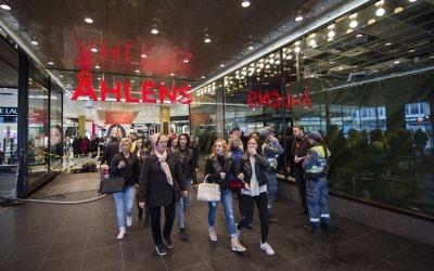 People are pictured at the Ahlens department store where a truck drove into in Stockholm, Sweden, on April 10, 2017. (AFP PHOTO / Jonathan NACKSTRAND)