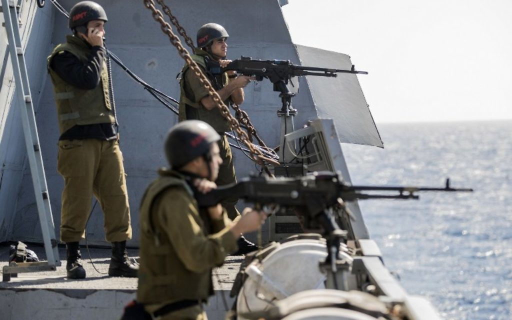 On warship once hit by Hezbollah, Israel readies for all