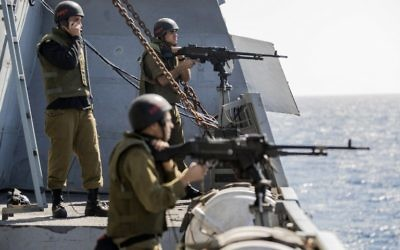 "Israeli soldiers onboard the Israeli vessel Saar 5 Class Corvette ""INS Hanit"" take part in the ""Novel Dina 17"" training session in the Mediterranean Sea on April 4, 2017 ( AFP PHOTO / JACK GUEZ)"