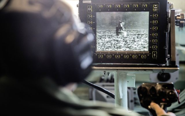 "An Israeli soldier onboard the Israeli vessel Saar 5 Class Corvette ""INS Hanit"" uses a video system called POP to identify ships and airplanes in the distances of several kilometers during the ""Novel Dina 17"" training session in the Mediterranean Sea on April 4, 2017. (AFP PHOTO / JACK GUEZ)"