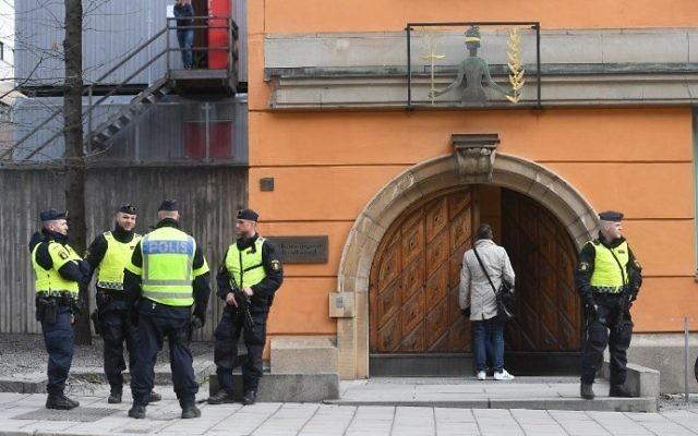 Policemen secure the entrance to the Stockholm District Court where Uzbek national Rakhmat Akilov, prime suspect in the Stockholm truck attack, appeared in court on April 11, 2017. (AFP Photo/TT News Agency/Fredrik Sandberg)