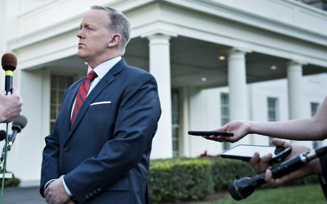 White House Press Secretary Sean Spicer speaks to a reporter about a comparison he made between Syria's President Bashar Assad and Adolf Hitler during an earlier press briefing at the White House April 11, 2017 in Washington, DC. (AFP Photo/Brendan Smialowski)