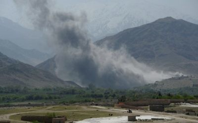 In this photograph taken on April 11, 2017, smoke rises after an air strike by US aircraft on positions during an ongoing an operation against Islamic State (IS) in the Achin district of Afghanistan's Nangarhar province. (AFP PHOTO / NOORULLAH SHIRZADA)
