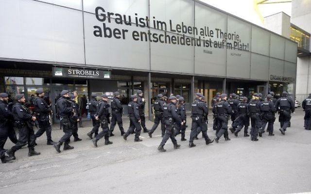 Police is seen outside the stadium prior to the UEFA Champions League 1st leg quarter-final football match BVB Borussia Dortmund v Monaco in Dortmund, western Germany on April 12, 2017. (AFP/Sascha Schuermann)