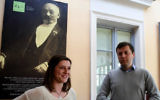 Przemyslaw Wierzbowski, Esperanto association president in the eastern Polish city of Bialystok and French student Amelie Chartier, who came to Bialystok to work at the Esperanto association through a European volunteer program stand in the Esperanto Cafe in front of the portrait of Ludwik Zamenhof on April 5, 2017. Zamenhof, the creator of the synthetic language of Esperanto, was born in 1859 just a few steps away from where the cafe is located. (JANEK SKARZYNSKI / AFP)