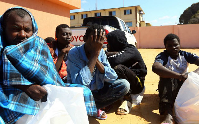 African migrants whose boat sank off the Libyan coast gather upon their rescue at the Tripoli branch of the Anti-Illegal Immigration Authority, in the Libyan capital on April 13, 2017. (Mahmud Turkia/AFP)