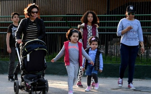 Tunisian visitors walk at the Belvedere Zoo, which was closed for renovation works following an attack on a crocodile a month earlier, in the capital Tunis on April 13, 2017. (AFP/ Fethi Belaid)