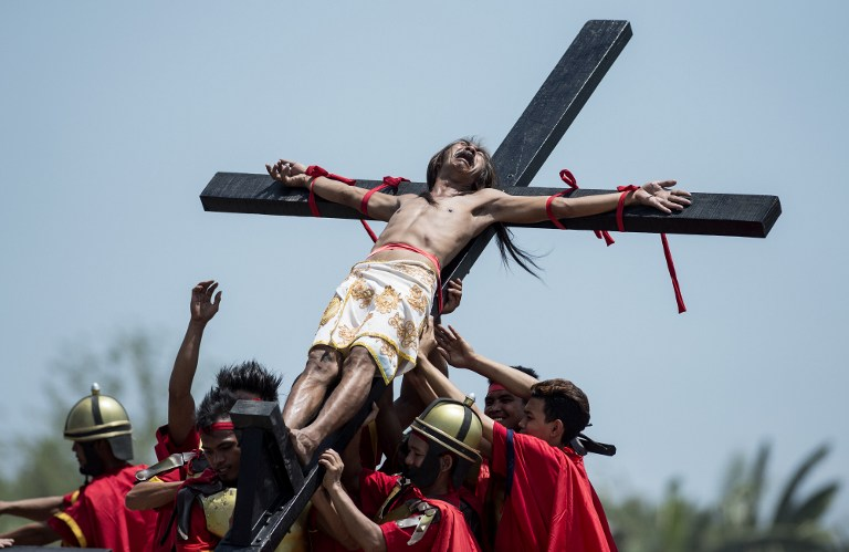 A Philippine Christian devotee reacts while nailed to a cross during a reenactment of the Crucifixion of Christ during Good Friday celebrations ahead of Easter in the village of Cutud near San Fernando, north of Manila on April 14, 2017. (Noel Celis/AFP)