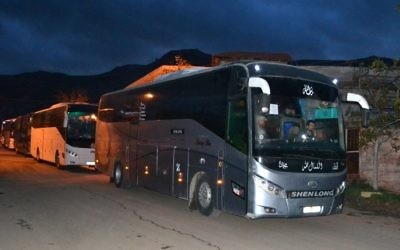 Buses carrying Syrian evacuees are seen in the rebel-held town of Madaya leaving under a deal brokered by opposition backer Qatar and regime ally Iran, on April 14, 2017. (AFP)