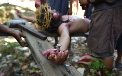 A penitent acting as Jesus is nailed to the cross as they re-enact the passion and death of Christ during the annual observance of Lent on Good Friday in Cainta town, Rizal province, east of Manila on April 14, 2017.  (Ted Aljibe/AFP)