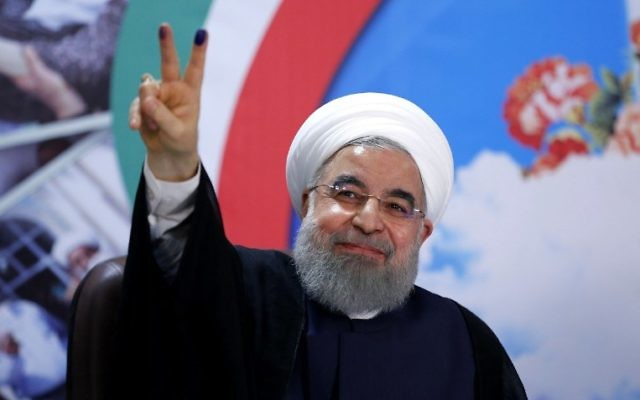 Iranian President Hassan Rouhani gestures to the camera after registering to run for re-election at the interior ministry in the capital Tehran on April 14, 2017 (AFP /ISNA / ATTA KENARE)