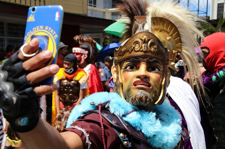 "A participant dressed as a centurion takes a selfie prior to a re-enactment of the passion and death of Christ during the annual observance of Lent on Good Friday called ""Moriones Festival"" in Boac town, Marinduque province, south of Manila on April 14, 2017. (Gretchen Malalad/AFP)"