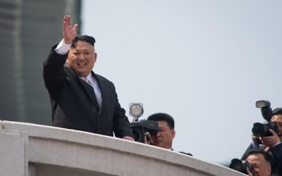 North Korean leader Kim Jong-Un waves from a balcony of the Grand People's Study house following a military parade marking the 105th anniversary of the birth of late North Korean leader Kim Il-Sung, in Pyongyang on April 15, 2017. (AFP PHOTO / ED JONES)