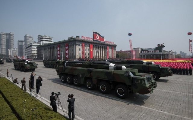 Unidentified missiles and mobile launchers make their way through Kim Il-Sung square during a military parade marking the 105th anniversary of the birth of late North Korean leader Kim Il-Sung in Pyongyang on April 15, 2017. (AFP PHOTO / ED JONES)