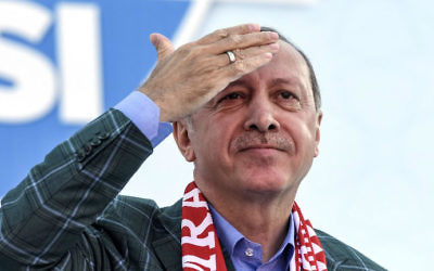 Turkish President Recep Tayyip Erdogan gestures as he delivers a speech during a rally on the eve of the constitutional referendum, on April 15, 2017 in Istanbul. (Bulent Kilic/AFP)
