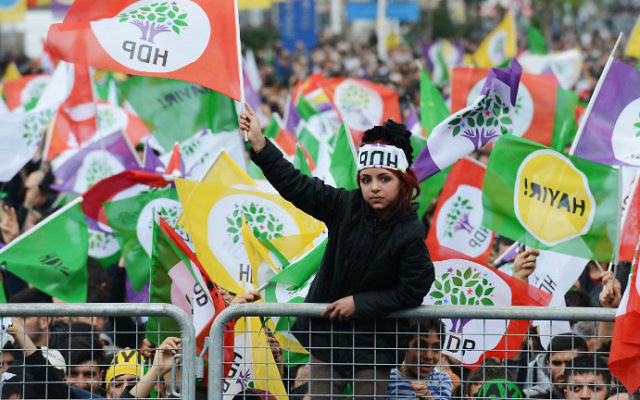 A young woman waves an HDP party flag as Kurdish people attend a rally of the opposition pro-Kurdish Peoples' Democratic Party (HDP), on the eve of the constitutional referendum, on April 15, 2017 in Diyarbakir, Turkey. (Ilyas Akengin/AFP)