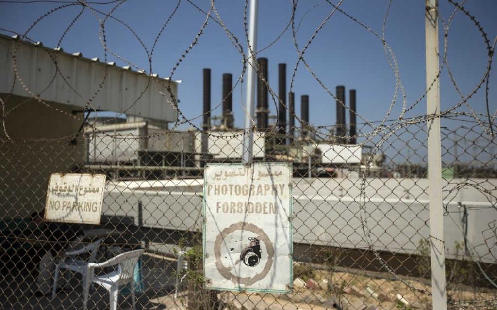 A power plant in Gaza City is pictured from behind a fence on April 16, 2017. (AFP/Mahmud Hams)