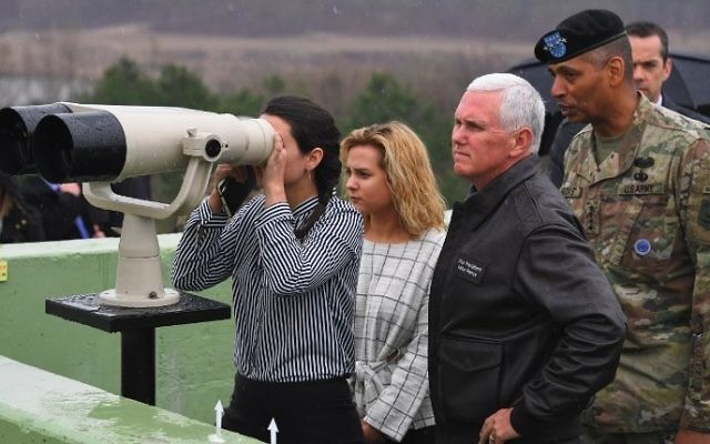 US Vice President Mike Pence (2nd R) visits Observation Post Ouellette with his daughters (L) near the truce village of Panmunjom in the Demilitarized Zone (DMZ) on the border between North and South Korea on April 17, 2017. (AFP PHOTO / JUNG Yeon-Je)