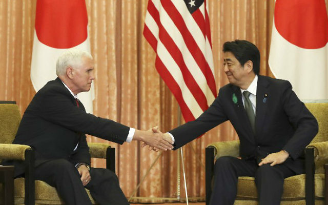 Japanese Prime Minister Shinzo Abe (R) and US Vice President Mike Pence shake hands prior to a luncheon hosted by Abe at the prime minister's official residence in Tokyo on April 18, 2017. (Eugene Hoshiko / POOL / AFP)