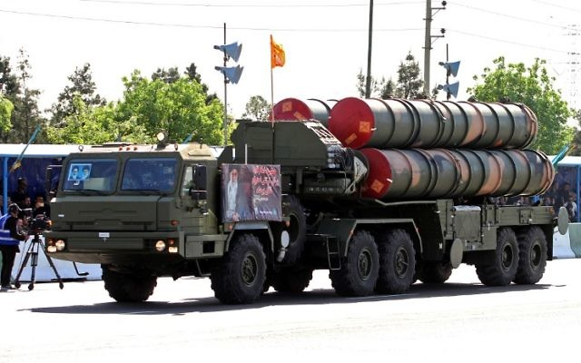 An Iranian military truck carries parts of the S-300 air defense missile system during a parade on the occasion of the country's National Army Day, in Tehran, April 18, 2017. (AFP/ATTA KENARE)