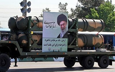 An Iranian military truck carries parts of the S-300 air defense missile system during a parade on the occasion of the country's Army Day, on April 18, 2017, in Tehran. (AFP Photo/Atta Kenare)