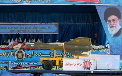 "An Iranian military truck with a picture of President Hassan Rouhan carries a rocket and displays a banner reading ""Death to Israel"" during a parade marking the country's National Army Day, in Tehran, April 18, 2017. (AFP/Atta Kenare)"
