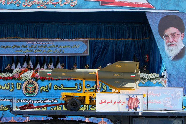An Iranian military truck displays a banner reading