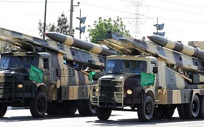 Iranian military trucks carry surface-to-air missiles during a parade on the occasion of the country's Army Day, on April 18, 2017, in Tehran. (AFP Photo/Atta Kenare)