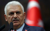 Turkey's Prime Minister Binali Yildirim addresses members of parliament from his ruling AK Party (AKP) as he arrives for a meeting at the Turkish parliament on April 18, 2017 in Ankara. (ADEM ALTAN / AFP)