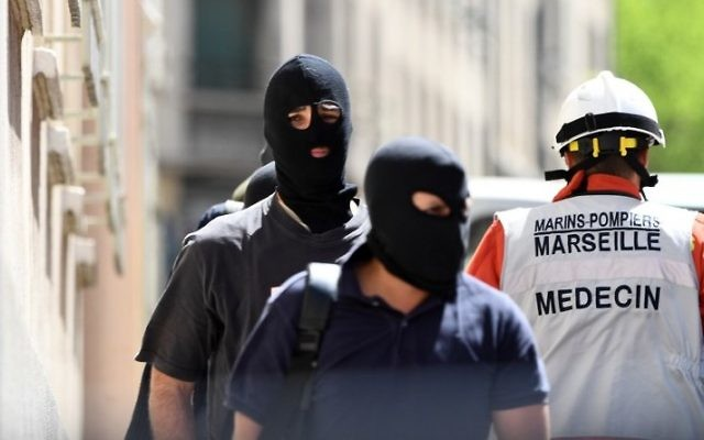 Illustrative: Members of the French Judiciary Police (PJ) and a naval firefighter after a police search at the home of one of the two men arrested in Marseille on suspicion of preparing an attack just days ahead of the first round of France's presidential vote, April 18, 2017. (AFP/Boris Horvat)