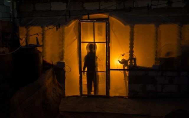 A silhouette of a Palestinian boy in the Khan Yunis refugee camp in the southern Gaza Strip on April 19, 2017. The Gaza Strip's only functioning power plant was out of action. (AFP/Mahmud Hams)