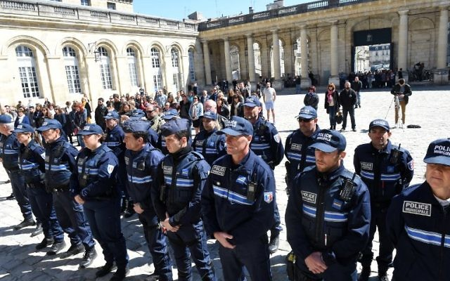 French municipal policemen observe a minute of silence on April 21, 2017 in the courtyard of the town hall in Bordeaux, southwestern France, to pay tribute to the police officer who was shot dead by an attacker on the Champs-Elysees the day before in Paris. (Mehdi Fedouach/AFP)