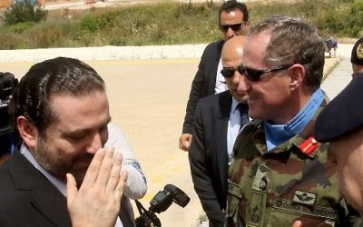 Lebanese Prime Minister Saad Hariri, left, gestures next to the Head of Mission and Force Commander of the United Nations Interim Force in Lebanon (UNIFIL), Major General Michael Beary, center, of Ireland, during a visit to the UNIFIL headquarters in the southern Lebanese village of Naqura on April 21, 2017.  (AFP/ Mahmoud ZAYYAT)