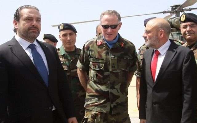Lebanese Prime Minister Saad Hariri, left, stands next to the Head of Mission and Force Commander of the United Nations Interim Force in Lebanon (UNIFIL), Major General Michael Beary, center, of Ireland, during a visit to the UNIFIL headquarters in the southern Lebanese village of Naqura on April 21, 2017. (AFP/Mahmoud Zayyat)