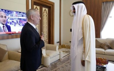Qatar's Emir Sheikh Tamim bin Hamad al-Thani (R) welcomes US Defense Secretary James Mattis at the Prince's Sea Palace residence in Doha, on April 22, 2017. (AFP Photo/Pool/Jonathan Ernst)